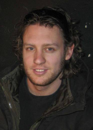 Director Neill Blomkamp of TriStar Pictures' sci-fi thriller DISTRICT 9.