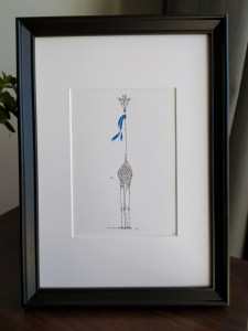 Calligram of a giraffe with blue scarf, framed