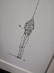 Detail calligram giraffe red scarf