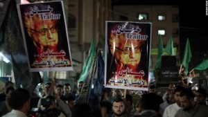 Between a rock and a hard place: Mahmood Abbas is seen as a traitor by some, a pushover by others. Here, protesters carry placards calling Mahmood Abbas a traitor, in the Gaza Strip. Image.