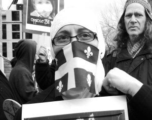 Protester of Bill 94, a defeated bill in Québec that would have mandated women to uncover their faces before receiving public services. Credit: scottmontreal, Flickr Community Commons. Cropped.