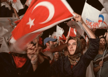 Supporters celebrate the AKP win