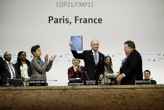 French Foreign Minister Fabius raise the final text - Public Domain COP21