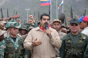 President Nicolás Maduro of Venezuela (centre) with General and Minister of Defence, Vladimir Padrino López (right) at a military training camp in May (2016). Credits: European Press Agency