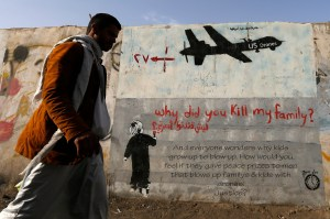 A man walks past graffiti denouncing US involvement in Yemen. https://flic.kr/p/MA4RAs