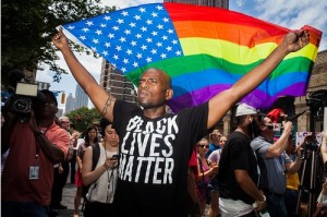 A member of Black Lives Matter expresses support for the Queer community at a Donald Trump rally in Atlanta, Georgia.
