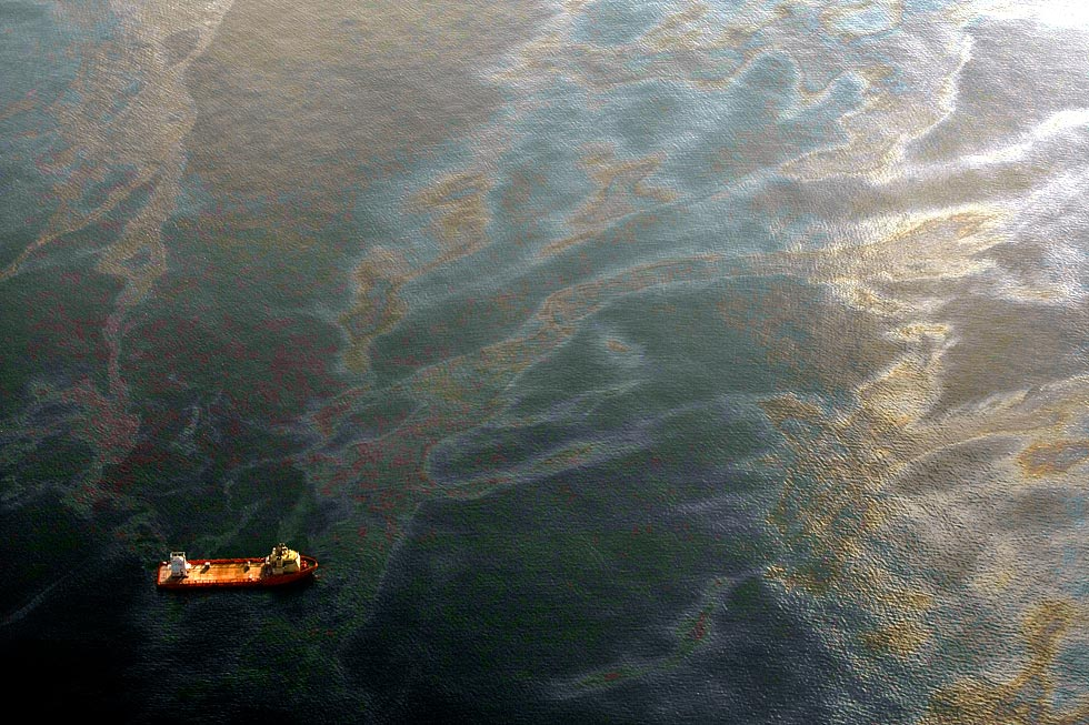The BP oil spill in the Gulf of Mexico, off the border of Louisiana in April, 2010. Photo Credit: thetruthdenied (Flickr Creative Commons).