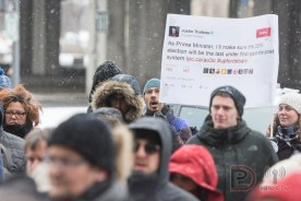 A previous tweet by Justin Trudeau is held high during a demonstration against the federal government's decision to remove electoral reform as a mandate. Credit: 99% Media Pierre-Luc Daoust