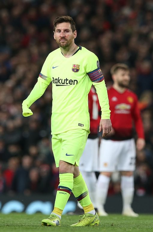 MANCHESTER, ENGLAND - APRIL 10: Lionel Messi of Barcelona receives treatment on a facial injury during the first match of the UEFA Champions League quarter-final between Manchester United and FC Barcelona at Old Trafford on April 10, 2019 in Manchester, England. . (Photo by Matthew Peters / Man Utd via Getty Images)