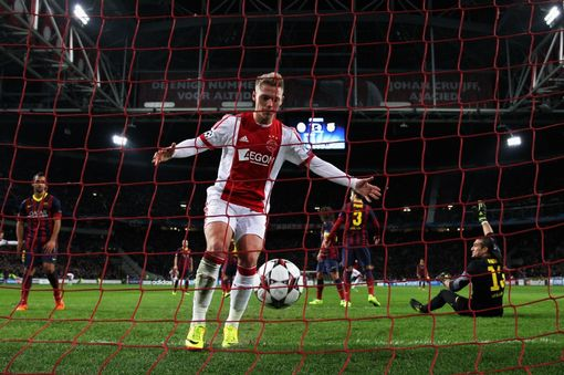 AMSTERDAM, NETHERLANDS - NOVEMBER 26: Viktor Fischer collects the ball from the net after Danny Hoesen (not in frame) of Ajax shoots and scores the second goal of the game during the UEFA Champions League Group H match between Ajax Amsterdam and FC Barcelona at Amsterdam Arena on November 26, 2013 in Amsterdam, Netherlands. (Photo by Dean Mouhtaropoulos/Getty Images)
