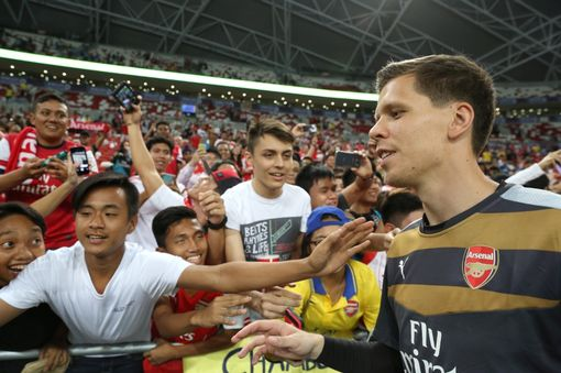 SINGAPORE - JULY 15: Wojciech Szczesny of Arsenal takes photographs with fans after the Barclays Asia Trophy match between Arsenal and Singapore Select XI at National Stadium on July 15, 2015 in Singapore. (Photo by Lionel Ng/Getty Images)