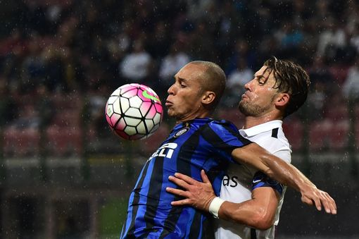 Inter Milan's defender from Brazil Joao Miranda (L) fights for the ball with Guglielmo Stendardo Atalanta's defender from Italy during the Italian Serie A football match Inter Milan vs Atalanta at the San Siro Stadium in Milan on August 23, 2015. AFP PHOTO / GIUSEPPE CACACEGIUSEPPE CACACE/AFP/Getty Images