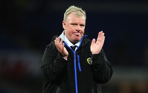 CARDIFF, UNITED KINGDOM - MARCH 08: Steve Evans, Manager of Leeds United applaudes the travelling fans at the final whistle during the Sky Bet Championship match between Cardiff City and Leeds United at the Cardiff City Stadium on March 8, 2016 in Cardiff, Wales. (Photo by Harry Trump/Getty Images)