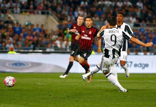 Juventus' Alvaro Morata scores a goal against AC Milan