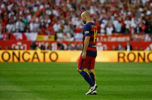 Barcelona's Javier Mascherano looks dejected after being sent off