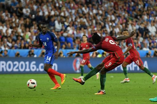 Eder of Portugal scores the opening goal