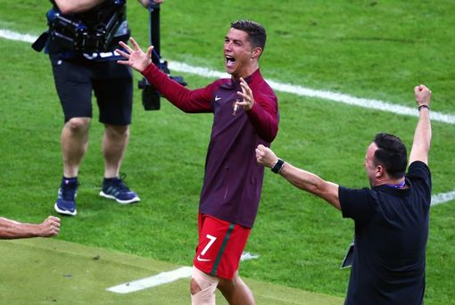 PARIS, FRANCE - JULY 10: Cristiano Ronaldo of Portugal celebrates winning at the final whistle during the UEFA EURO 2016 Final match between Portugal and France at Stade de France on July 10, 2016 in Paris, France. (Photo by Alex Livesey/Getty Images)