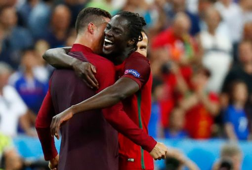 Cristiano Ronaldo and Eder celebrate after winning Euro 2016