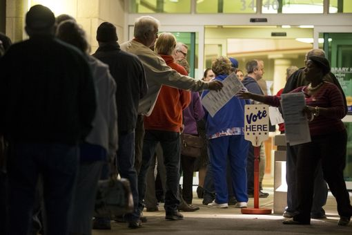 Sample ballots are collected as voters wait for polls to open on November 8, 2016 at the Midwest Genealogy Center Library in Independence, Missouri