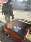 Moari cooking over natural heat, Whakarewarewa Maori village, North Island