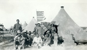 Legionaires from the US trained in Cyprus, pictured here with the tattered American flag they refused to give up.