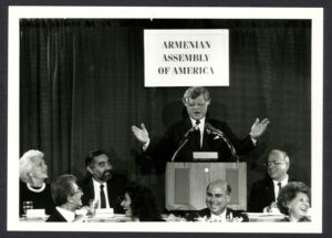 Sen. Edward Kennedy spoke at the 1987 Armenian Assembly National Conference and Tribute Gala in Boston. Also pictured in the photo, seated from left to right, former First Lady Barbara Bush, Assembly Board of Trustees Chairman Hirair Hovnanian and Assembly Board of Directors Chairman Jirair Haratunian.