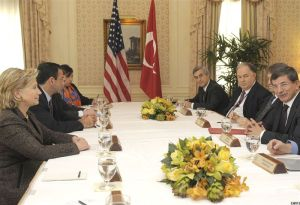 Secretary of State Hillary Clinton with Philip Gordon by her side, speaking to the Turkish foreign minister