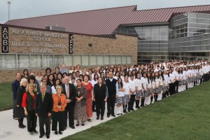 High school students and teachers in front of the new building.