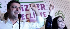 Selahattin Demirtas (L) and Figen Yukseldag (R), co-chairs of the pro-Kurdish Peoples' Democratic Party (HDP), gesture during a press conference in Istanbul on June 7, 2015.  Turkey's Islamic-rooted ruling party lost its absolute parliamentary majority in legislative elections, dealing a severe blow to strongman President Recep Tayyip Erdogan's ambition to expand his powers. In a sensational result that shakes-up Turkey's political landscape, the pro-Kurdish People's Democratic Party (HDP) easily surpassed the 10 percent barrier needed to send MPs to parliament. AFP PHOTO / OZAN KOSE        (Photo credit should read OZAN KOSE/AFP/Getty Images)