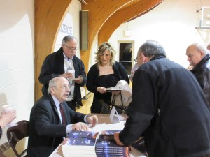Dr. Herand Markarian signs copies of his book.
