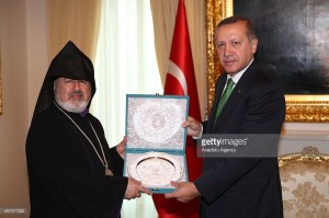 ANKARA, TURKEY - MAY 01:  Turkish Prime Minister Recep Tayyip Erdogan (R) receives Deputy Patriarch Archbishop Aram Atesyan (L) of the Turkish-Armenian Patriarchate, at the Turkish PM's official residence on May 01, 2014 in Ankara, Turkey. (Photo by Kayhan Ozer/Anadolu Agency/Getty Images)
