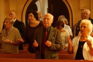 Parishioners unite in prayer.