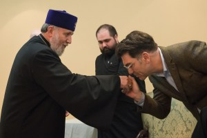 Artist Michael Aram kisses the hand of Catholicos Karekin II.