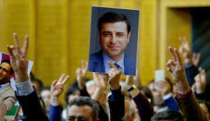 "A supporter holds a portrait of Selahattin Demirtas, detained leader of Turkey's pro-Kurdish opposition Peoples' Democratic Party (HDP) at a meeting at the Turkish parliament in Ankara, Turkey, November 8, 2016, in the absence of Demirtas and other HDP lawmakers who were jailed after refusing to give testimony in a probe linked to ""terrorist propaganda"".  REUTERS/Umit Bektas"