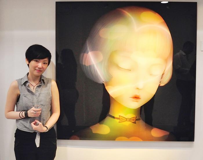 """Sonya Fu next to her work """"I love"""" (2014) at AP Contemporary, Hong Kong"""