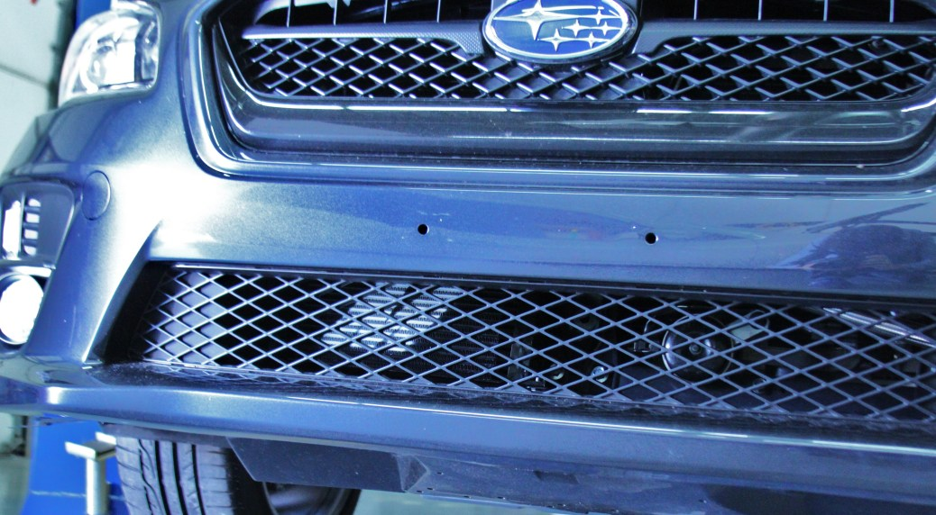 19-row oil cooler mounted with bumper installed on the WRX
