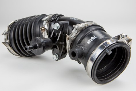 The stock induction hose serves not only as a coupler between the airbox and the metal induction pipe, but also as a home for emissions equipment such as the EVAP valve.