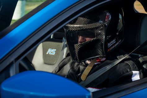 A suited-up Eric Plebani gets ready to set off for a round of testing to the RS's AWD system.