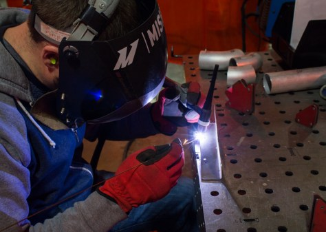 Our fabricator, Mike, works on securing a pair of our universal catch can brackets to a mounting plate for use as a preliminary prototype. Our production bracket will sport a much more fashionable appearance