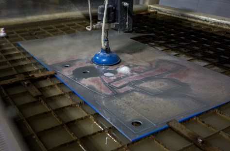 Our tank starts as a flat piece of metal. Using our water jet, we can cut the pieces for an expansion tank 3D puzzle.