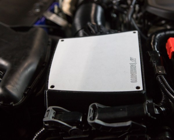 We fully intend on providing a lid with this intake kit, but you'll have to wait and see what it will be made of.