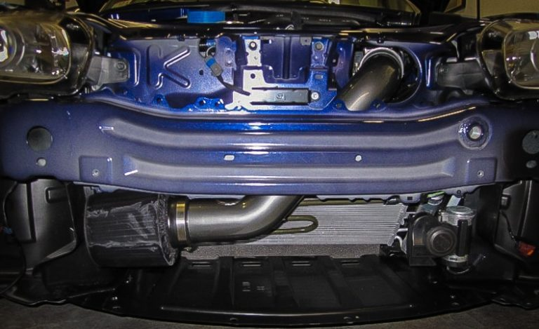 """A low-mount cold air intake on an NC Miata. <a href=""""https://low-offset.com/mazda/best-miata-cold-air-intake/"""">(Source)</a>"""