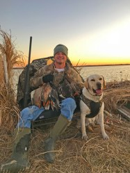 Retired U.S. Air Force veteran, Tyler Densford, enjoys the spoils of the hunt with his dog, Able.