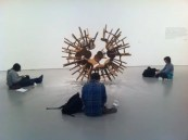 """Students gathered around """"Grapes"""" by Ai Weiwei"""