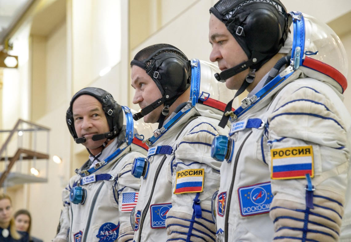 Expedition 47 crew members: NASA astronaut Jeff Williams, left, Russian cosmonauts Alexei Ovchinin, center, and Oleg Skripochka of Roscosmos line up to meet with management on their final day of Soyuz qualification exams, Thursday, Feb. 25, 2016, at the Gagarin Cosmonaut Training Center (GCTC) in Star City, Russia. Photo Credit: (NASA/Bill Ingalls)