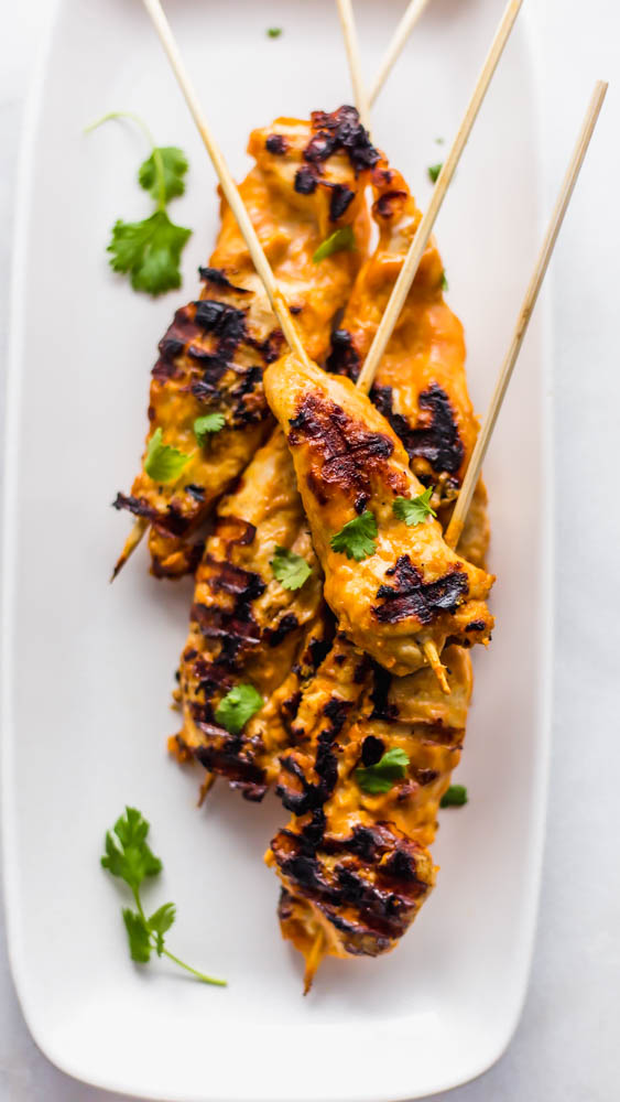Easy, Thai inspiredWhole30 Cashew Chicken Satay Skewers with Chili Cashew Dipping Sauce is the perfect, non-boring recipe you need to make for dinner.This healthy recipe has marinated chicken on skewers and is grilled to perfection. Served with a slightly spicy cashew dipping sauce it is so authentic and peanut free. Paleo and Whole30 Compliant #whole30 #paleo #dairyfree #glutenfree #dinner #healthy #healthyrecipe #recipe #dinnerrecipe #paleorecipe #whole30recipe