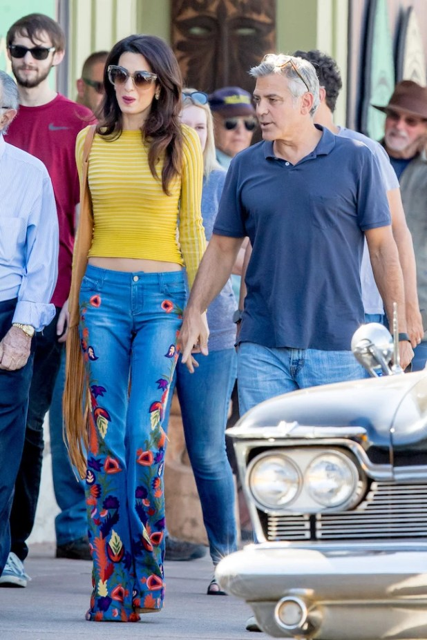 George Clooney and wife Amal Cooney seen holding hands as they walked their dog on the set of Suburbicon in Los Angeles, CA Pictured: George Clooney and Amal Clooney Ref: SPL1376970 201016 Picture by: Splash News Splash News and Pictures Los Angeles: 310-821-2666 New York: 212-619-2666 London: 870-934-2666 photodesk@splashnews.com