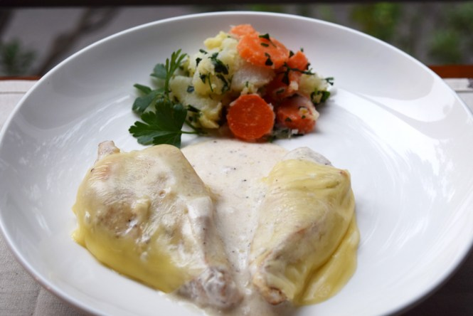 cheesy chicken served with side dish