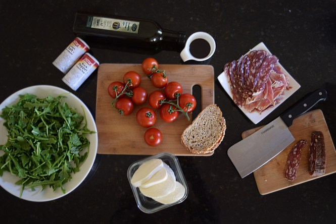 Ingredients for Tomato and Mozzarella salad with pumpkin seed oil