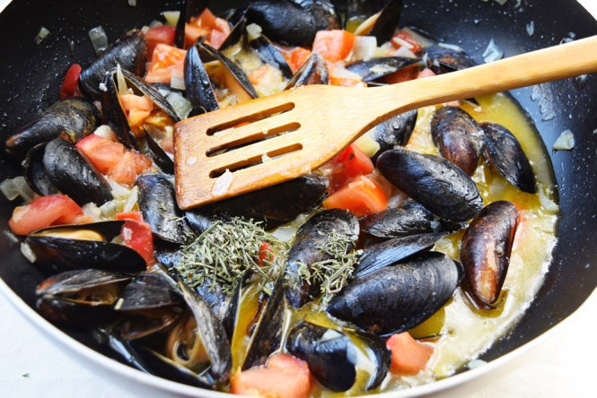 Add Herbs to Mussel Shrimp Buzara